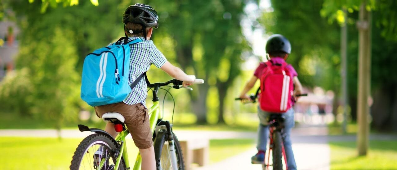 Children on bikes riding to Crandall Independent School District