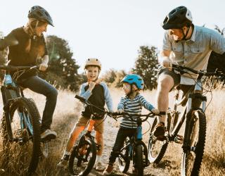 Family biking in a field