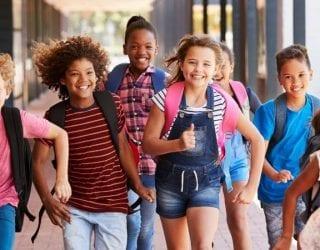 Grade school students walking down hallway