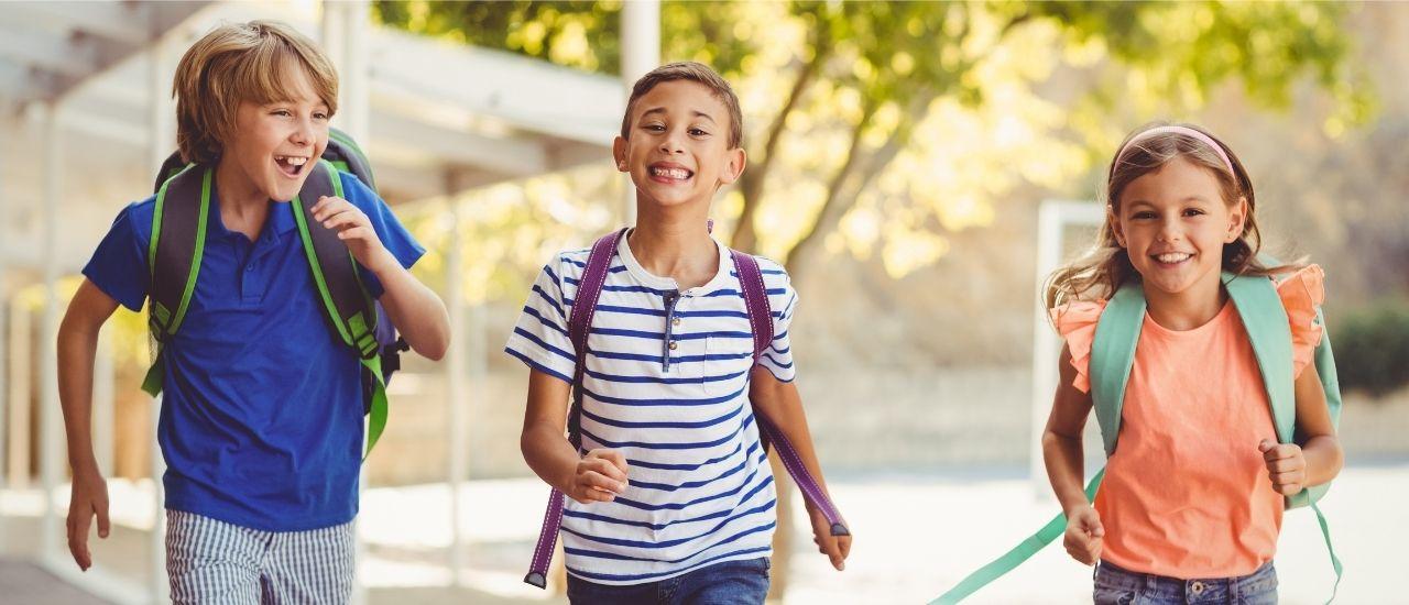 3 kids running going back to school near wildcat ranch